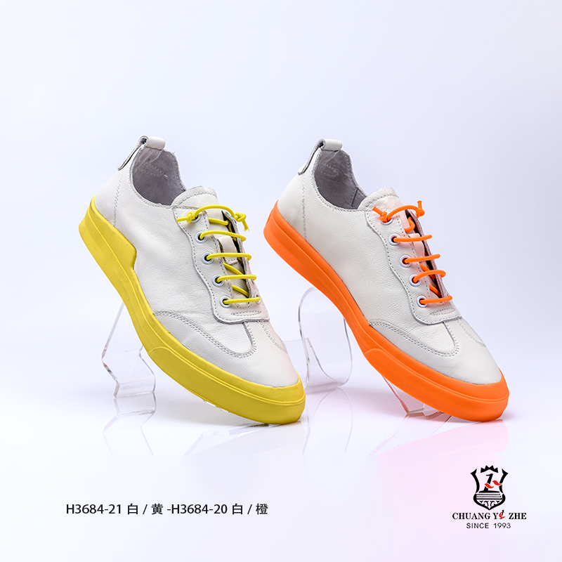 橙、白色时尚休闲平板鞋